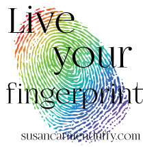 "a rainbow fingerprint with the text ""live your fingerprint."